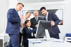 Business team in front of computer Royalty Free Stock Photo