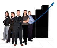 Business team in front of a graph Royalty Free Stock Photos