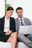 Business team in front of a laptop computer Royalty Free Stock Image