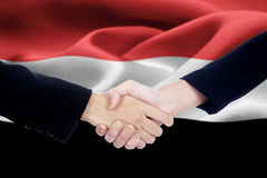 Business team in front of Yemen flag Stock Image