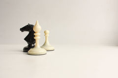Business team game concept. Black horse and white elephant with pawn. Chess pieces are black. Photo for your design Royalty Free Stock Photos