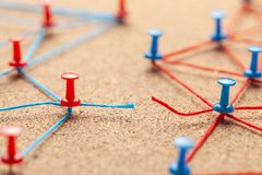 Business team. The gap is due to contact between people. Office pins linked by blue thread and broken link between two teams. Business team. The gap is due to royalty free stock image