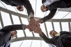 business team gather hands in city Stock Images
