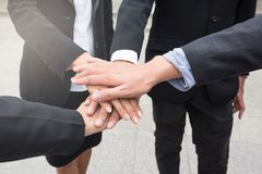 Business team gather hands on top of each other. Close up photo of business team gather hands on top of each other for successful project partners. working team Stock Images