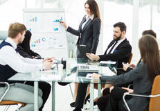 business team gives a presentation of a new financial project for the business partners of the company Stock Photos