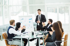 business team gives a presentation of a new financial project for the business partners of the company Royalty Free Stock Photos
