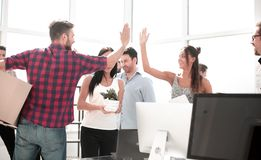 Business team is giving each other a high five in the new office. Photo with copy space royalty free stock images