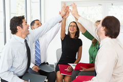 Business Team Giving One Another High Five Stock Images