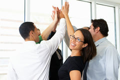 Business Team Giving One Another High Five stock photo