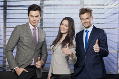 Business team giving thumbs up. Successful business team giving thumbs up royalty free stock photography