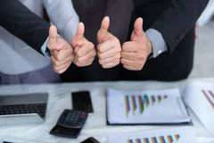 Business team are giving thumbs up of achievement project, Business concept. Business team are giving thumbs up of achievement project., Business concept stock images