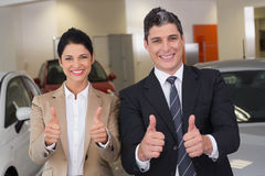 Business team giving thumbs up Royalty Free Stock Image