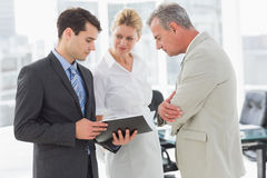 Business team going over documents Royalty Free Stock Images