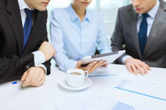 Business team with graph, tablet pc and coffee Royalty Free Stock Images