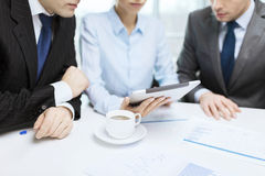 Business team with graph, tablet pc and coffee Royalty Free Stock Photos