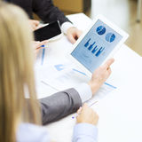 Business team with graph on tablet pc screen stock photo