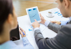 Business team with graph on tablet pc screen Royalty Free Stock Image