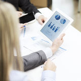 Business team with graph on tablet pc screen Stock Photos