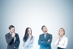 Business team, gray wall, toned Stock Images