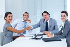 Business team greeting each other Royalty Free Stock Photography