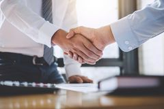 Business team greeting and finishing up a meeting, Two Business stock photos