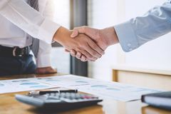 Business team greeting and finishing up a meeting, Two Business stock images