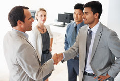 Business team greeting in office Stock Image