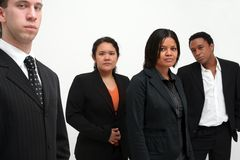 Business Team - group of four. Image of 4 people in a business team, serious, confident concept to image, diverse racial team stock images