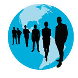 Business team group in front of a globe Royalty Free Stock Photography