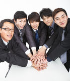 Business team with hand together. Asian business team with hand together on the table Stock Image