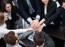 Business team with hands clasped together on Desk Stock Image