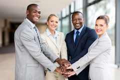 Business team hands together. Successful business team putting their hands together stock image