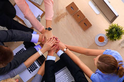 Business team with hands together - teamwork concepts.  Royalty Free Stock Photos