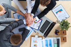 Business team with hands together - teamwork Royalty Free Stock Images