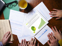 Business team hands at work with financial reports and a tablet Royalty Free Stock Photo
