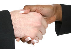 Business Team Handshake. Business handshake over whtie background, caucasian male, african american female hands royalty free stock photo