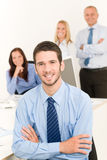 Business team handsome businessman with colleagues Stock Photo