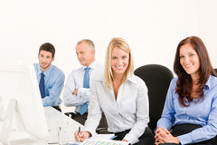 Business team happy sit in line behind table. Business team attractive women sit in line behind computer table Royalty Free Stock Images