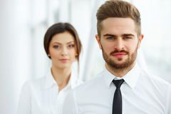 Business Team. Happy smiling people standing in office Royalty Free Stock Image