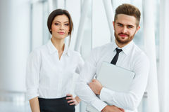 Business Team. Happy smiling people standing in office Stock Images