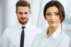 Business Team. Happy smiling people standing in a row at office Royalty Free Stock Images