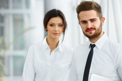 Business Team. Happy smiling people standing in a row at office Stock Image