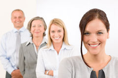 Business team happy standing in line portrait. Business team happy attractive women colleagues standing in line portrait Royalty Free Stock Photos