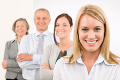 Business team happy standing in line portrait. Business team happy attractive women colleagues standing in line portrait Stock Image