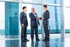 Business team having agreement and handshake stock photography