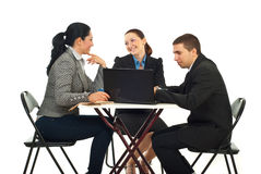 Business team having a break. Business team having conversation or searching on laptop in a coffee shop and sitting on chairs at table isolated on white Stock Photo
