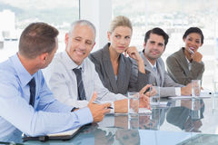 Business team having conversation at conference Royalty Free Stock Photos