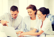 Business team having discussion in office. Friendly business team having discussion in office royalty free stock photos