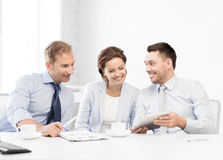 Business team having fun with tablet pc in office Stock Photography