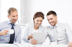 Business team having fun with tablet pc in office. Happy business team having fun with tablet pc in office Royalty Free Stock Photos